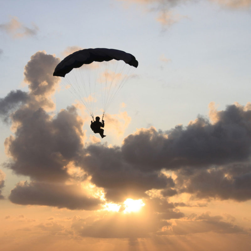 Sunset behind cloud and Paraglider